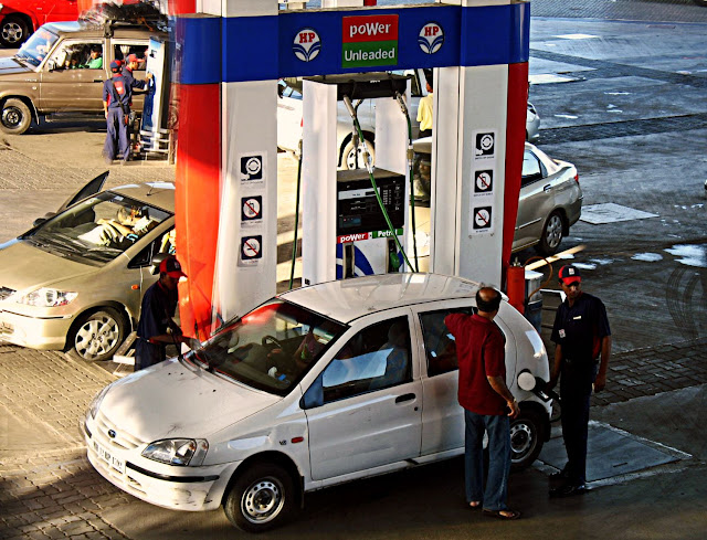 petrol being filled at gas station