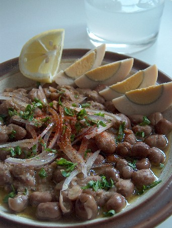 Ful medames served with sliced hard-boiled eggs