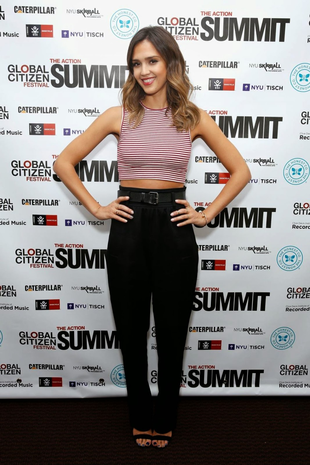 Jessica Alba flaunts cropped top and trousers at the Global Citizen Festival in NYC