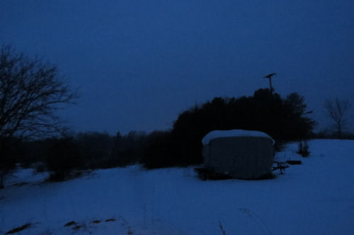 covered travel trailer in blue dusk
