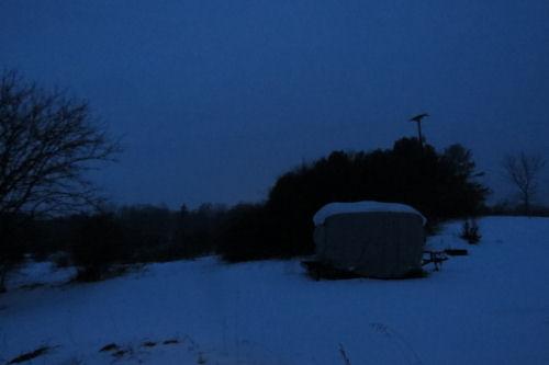 covered travel trailer in blue dusk