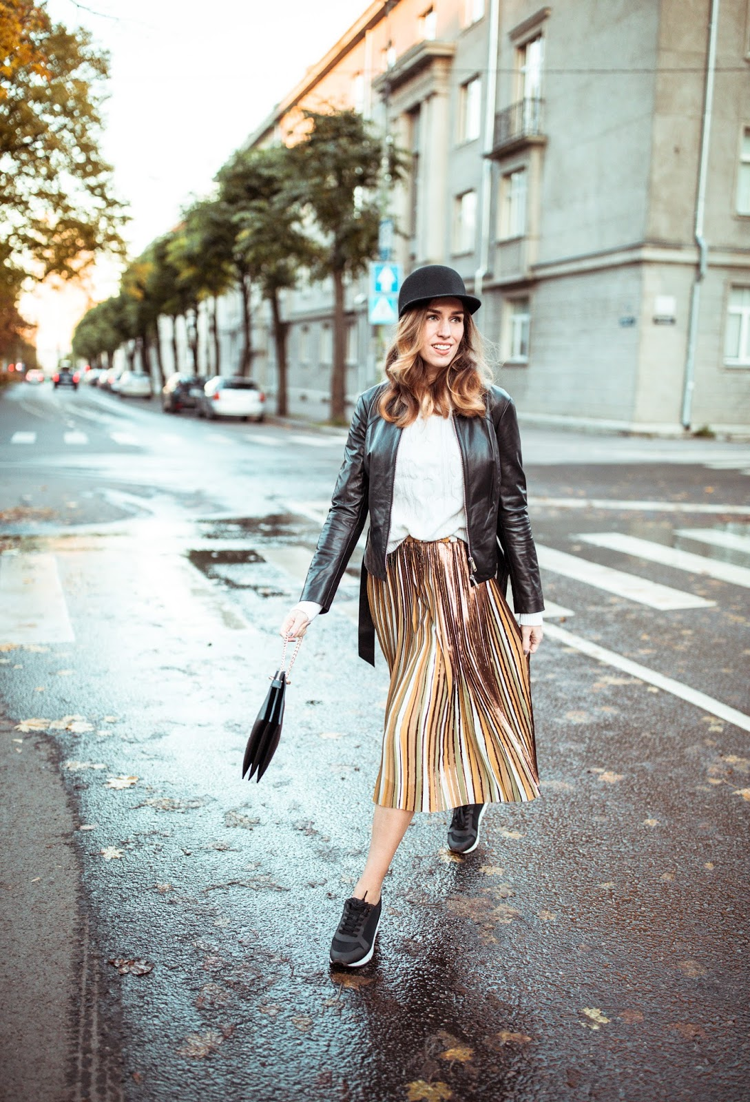 pleated skirt outfit sweater leather jacket sneakers