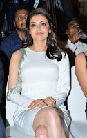 Beautiful Smiling Kajal Aggarwal in Creamy White Gown at MLA Telugu Movie Success Meet ~ .com Exclusive Pics 007.jpg