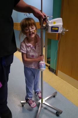 Jessica riding on her IV pole