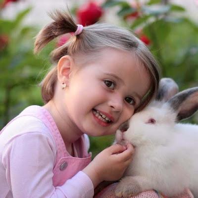 cuty-babygirl-kissing-white-rabbit-walls