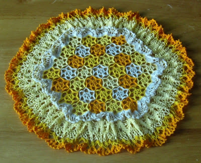 Field of Flowers Doily with Yellow and Orange Flowers By RSS Designs In Fiber