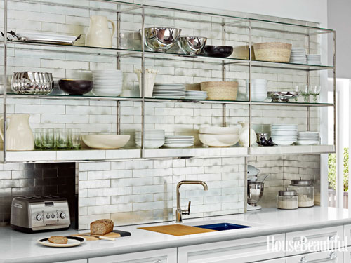 These industrial hanging kitchen shelves look amazing against the marble backsplash