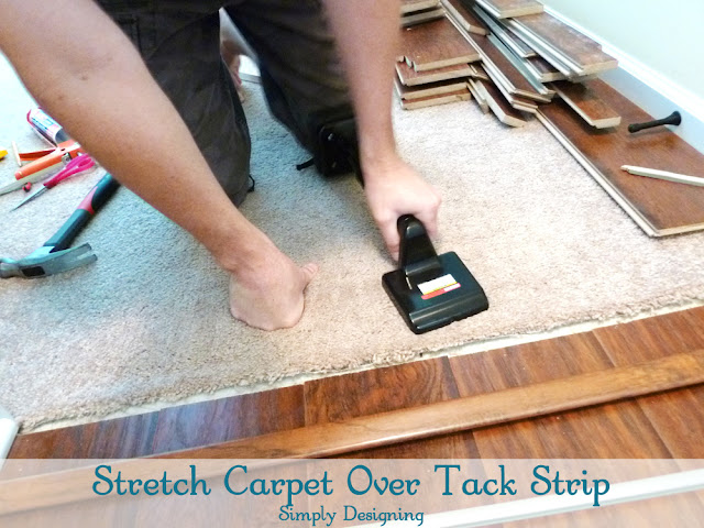 Stretch Carpet Over Tack Strip | #diy #carpet #laminateflooring #flooring #homeimprovement | at Simply Designing
