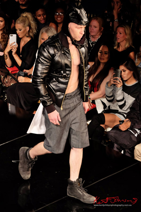 Black leather bondage strap style jacket and hood, reminiscent of Batman with grey shorts and Punk bum flap. Dexter Simmons at Art Hearts Fashion NYFW 2017 photographed by Kent Johnson.