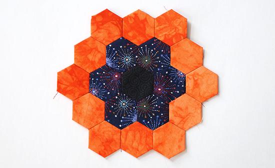 EPP Hexagon Flower Block 16 with Dark Fireworks and Bright Orange Batik