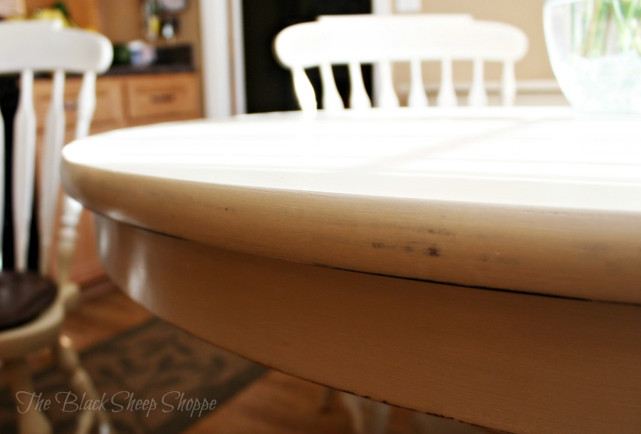 The table top is smooth and the paint lightly distressed.