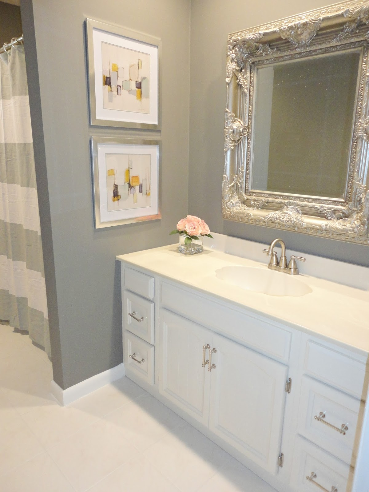 ... her 1970s bathroom on the cheap just by using paint! LOVE this
