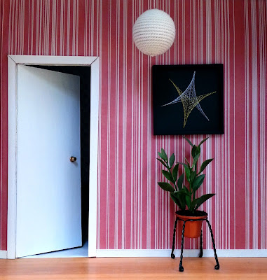 Modern dolls' house miniature 1970s-style hallway.