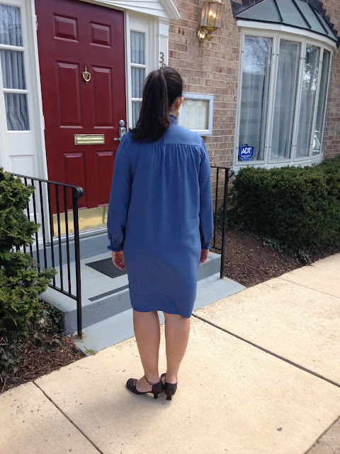 A blue crepe dress with high button-up nick and bishop sleeves using the Simplicity 8166 sewing pattern.