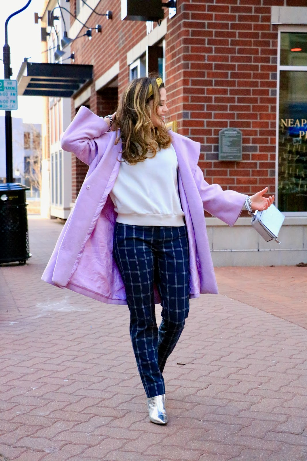 Nyc fashion blogger Kathleen Harper showing how to dress up a sweatshirt