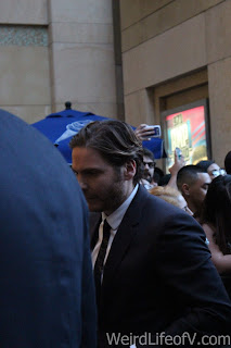Daniel Bruhl walking the red and blue carpet