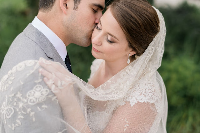 groom kiss on the cheek