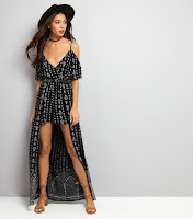 http://www.newlook.com/shop/womens/playsuits-and-jumpsuits/black-cold-shoulder-dip-hem-playsuit-_524383509