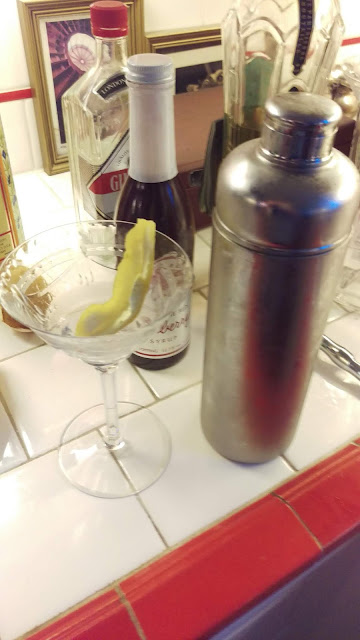 Pour the contents of the glass into a shaker with ice and shake.