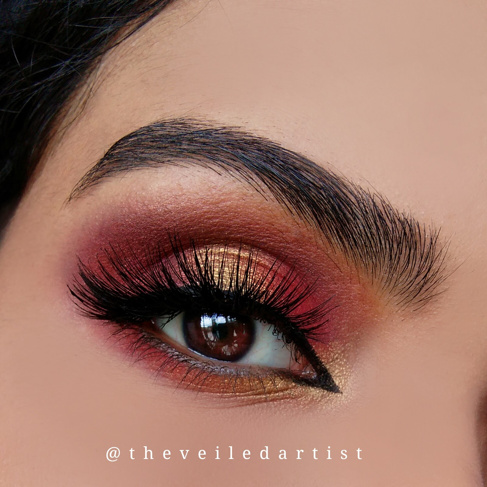 red and gold halo smokey eyes with dramatic arabic winged liner