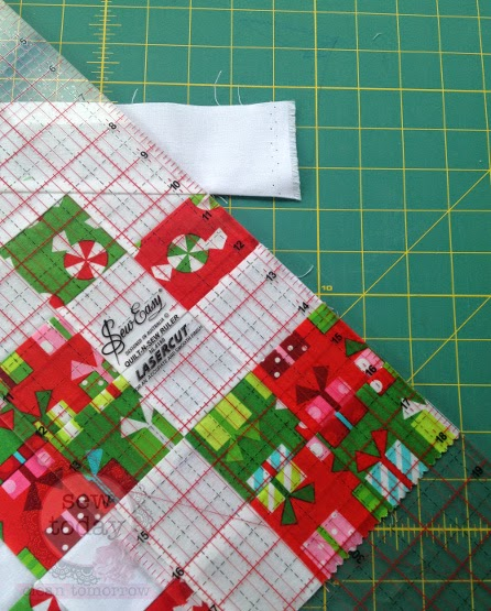Line up the ruler with the table runner edges