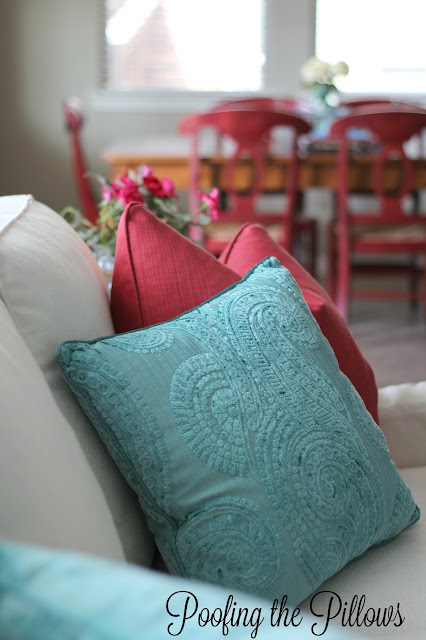 sofa, blue pillow, red pillow, decorating your home for your family