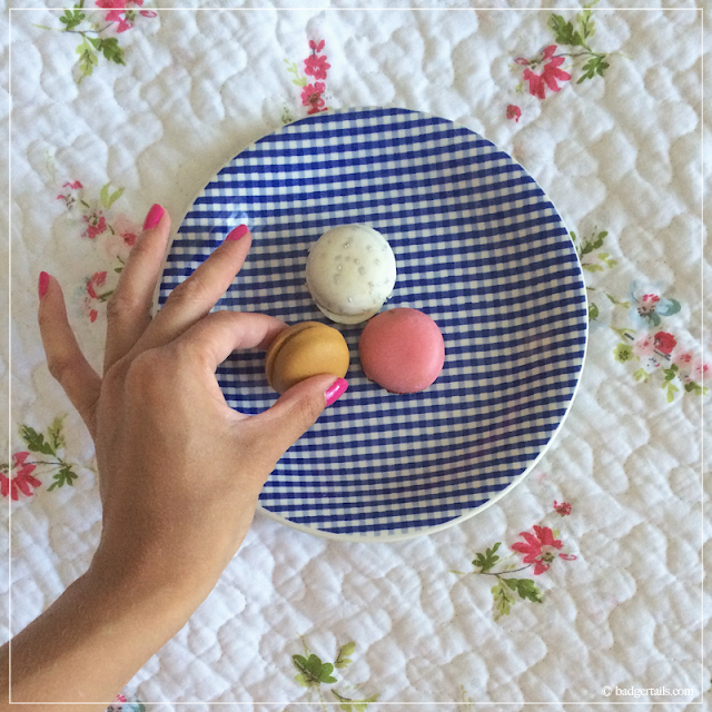 Woman's-Hand-Taking-Pastel-Parisienne-Macaron