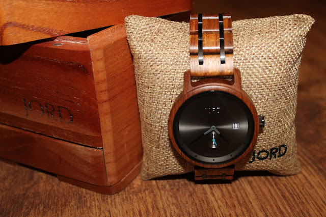 wooden watch around a hessian pillow resting against a wooden box