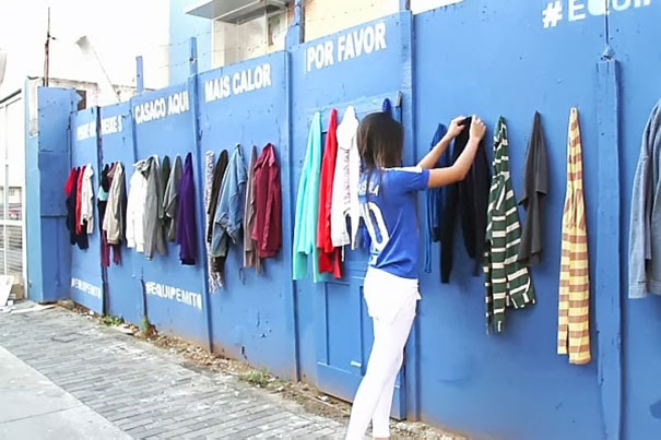 A wall of donated clothes for homeless people to take.