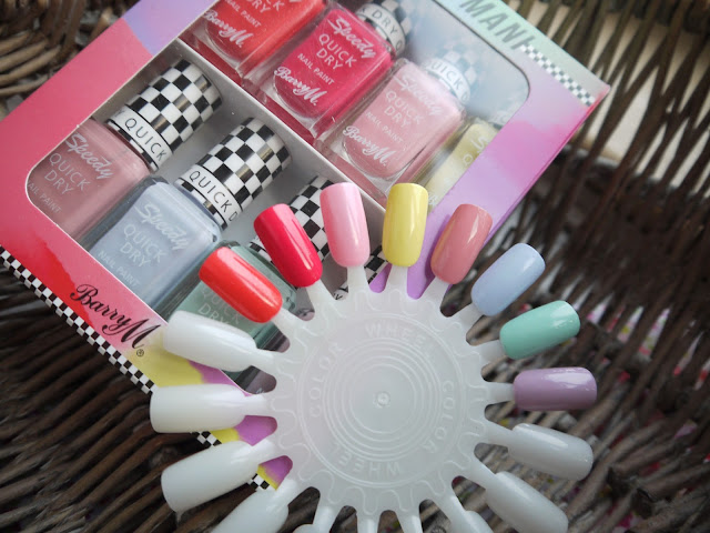 a box of barry m speedy quick dry nail varnishes, plus swatches on a wheel