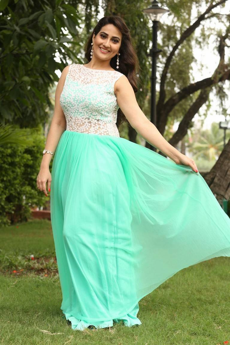 Glamours Tv Anchor Manjusha Stills At Movie Success Meet In Green Dress