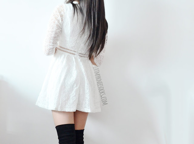 A cute spring/autumn outfit featuring SheIn's white crochet three-quarter sleeve deep-V neckline lace-up front cutout flared skater dress, worn with black over-the-knee suede boots.