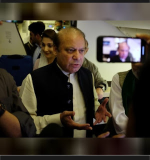 Ousted Pakistan PM arrested on return, as bomber kills scores