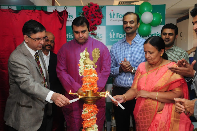 Lighting the lamp_Dr.Jayateerth Kulkarni ,by Mr Promod Madhwaraj, Minister Sports Department,, Dr Sarala, Chief , Sports Authority of India(from left)