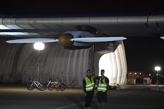Ground crew members support the starboard wing of Solar Impulse 2, Moffett Field, Mountain View, California