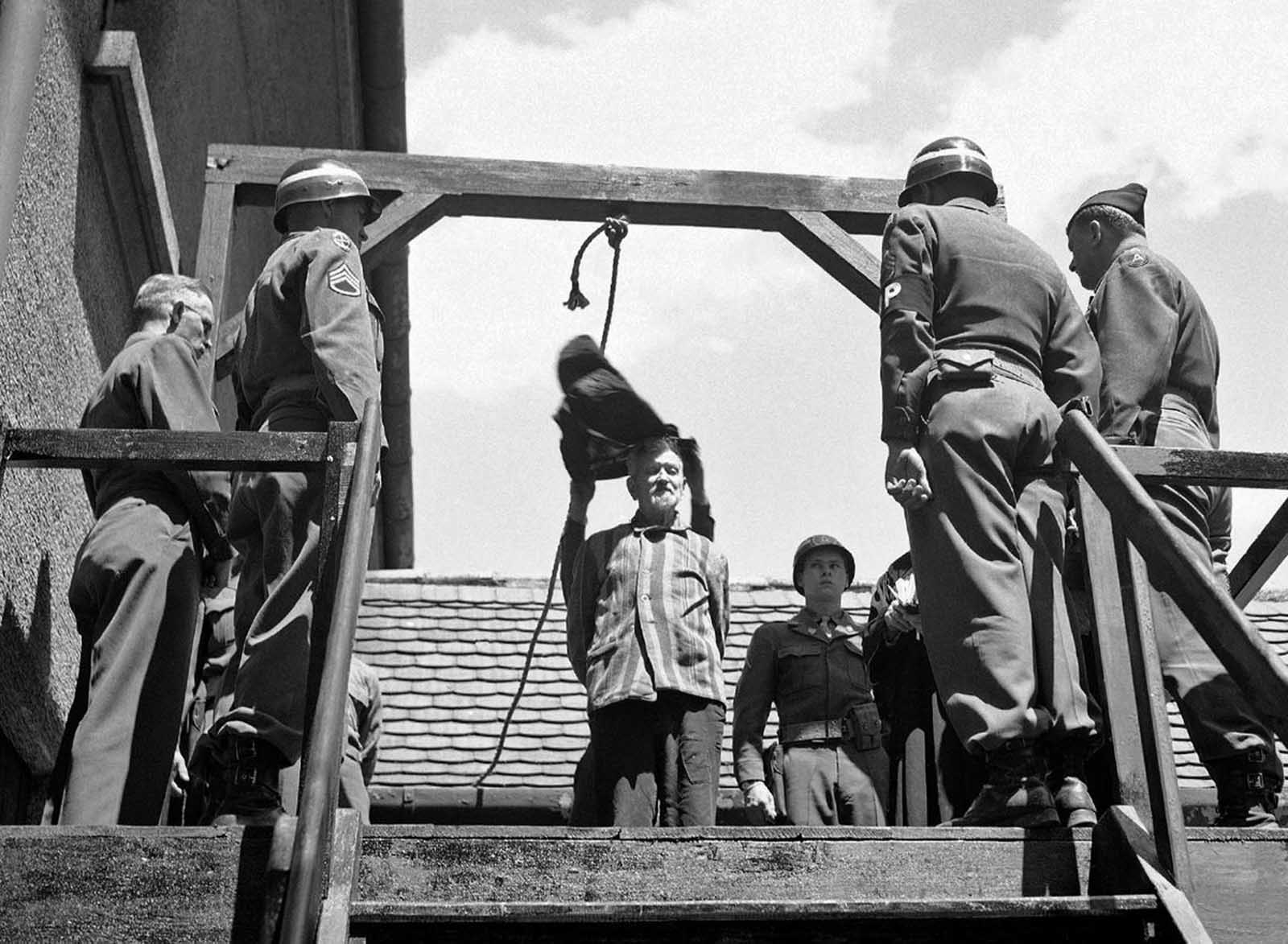 U.S. military authorities prepare to hang Dr. Klaus Karl Schilling, 74, at Landsberg, Germany, on May 28, 1946. In a Dachau war crimes trial he was convicted of using 1,200 concentration camp prisoners for malaria experimentation. Thirty died directly from the inoculations and 300 to 400 died later from complications of the disease. His experiments, all with unwilling subjects, began in 1942.