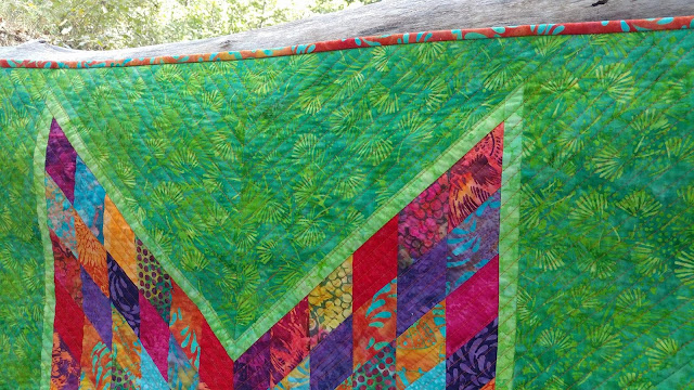 Scrappy Lonestar quilt using Empress Garden fabrics by Island Batik