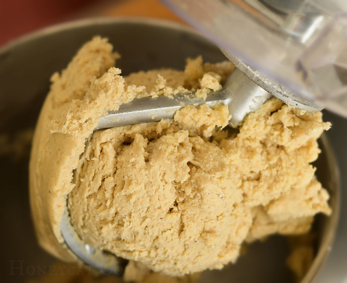 Close up of sugar cookie dough on K beater after mixing, photo by Honeycat Cookies