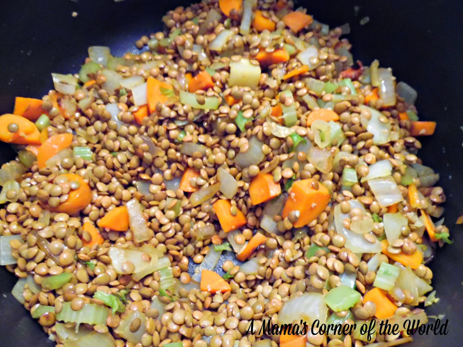 Lentils coated in the vegetable and spice mixutre before adding the broth and water to the soup
