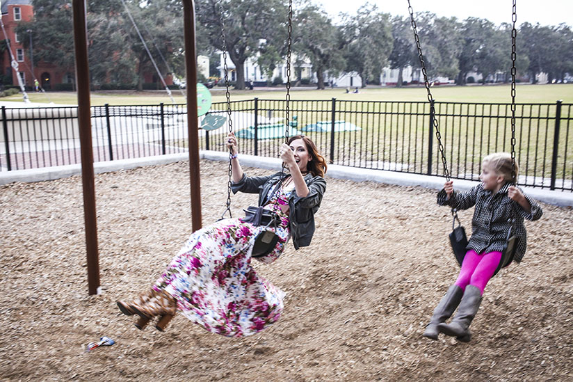 Amy West and daughter swing in Forsyth Park