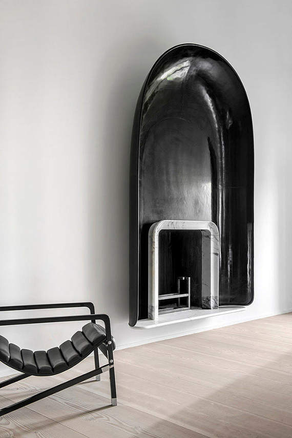 Black arched fireplace. Photo by Bernard Touillon