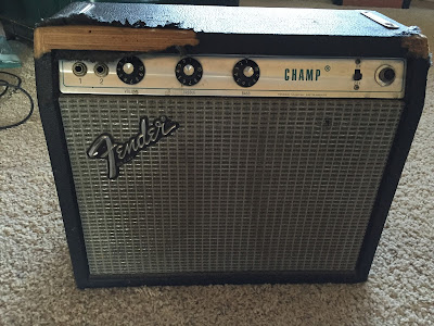 Beat up Fender Champ Silverface amplifier