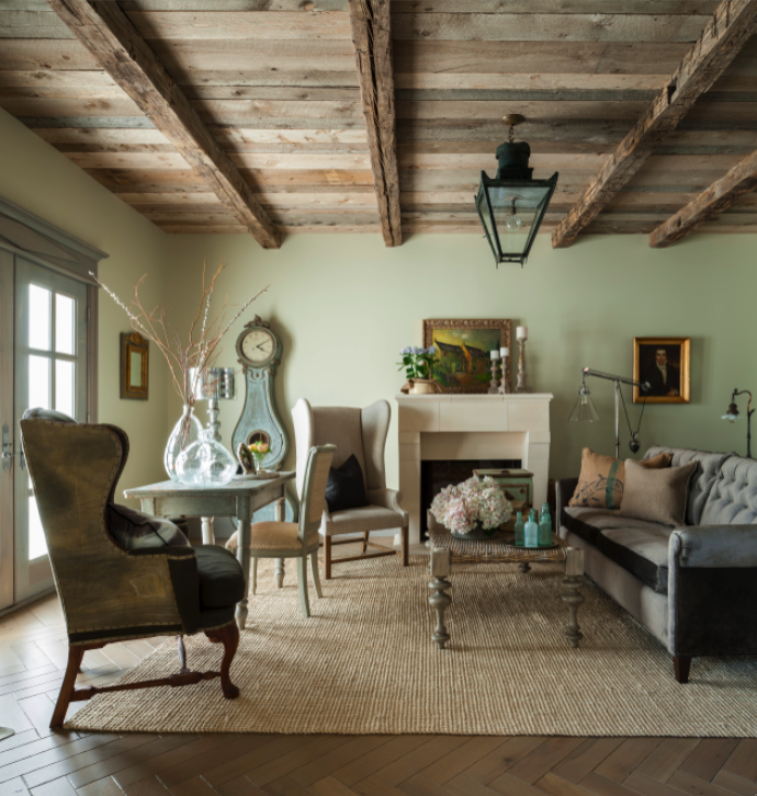 French Nordic living room with rustic wood ceiling and Mora clock. Come see this Rustic Elegant French Gustavian Cottage by Decor de Provence in Utah! #frenchcountry #frenchfarmhouse #interiordesigninspiration #rusticdecor #europeanfarmhouse #housetour