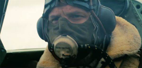 image of Tom Hardy as a spitfire pilot wearing an oxygen mask that covers most of his face in Dunkirk