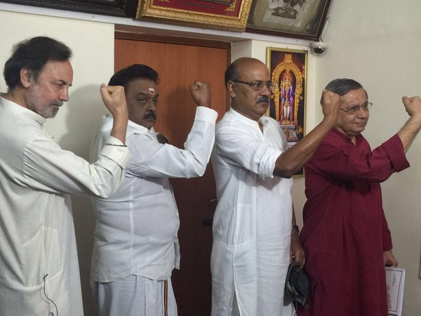 Journalist Shekar Gupta has posted a hilarious photo of NDTV election coverage team posing with Tamil Nadu actor-politician  Captain Vijayakanth.   Dr Prannoy Roy, Dorab Sopariwala, Shekhar Gupta and Captain Vijayakanth are seen raising their right hand with clenched fist in unison.