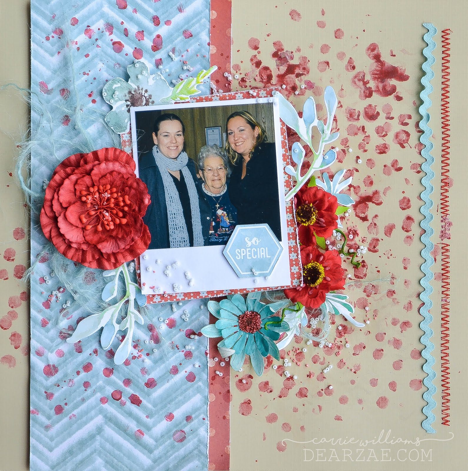 Blue and red scrapbook layout with flowers, die cuts, seed beads, stitching, and ric rac