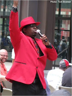 Theo Huff works the crowd at the 2016 Chicago Blues Festival Preview event at Chicago's Daley Plaza | Photograph by Tom Bowser