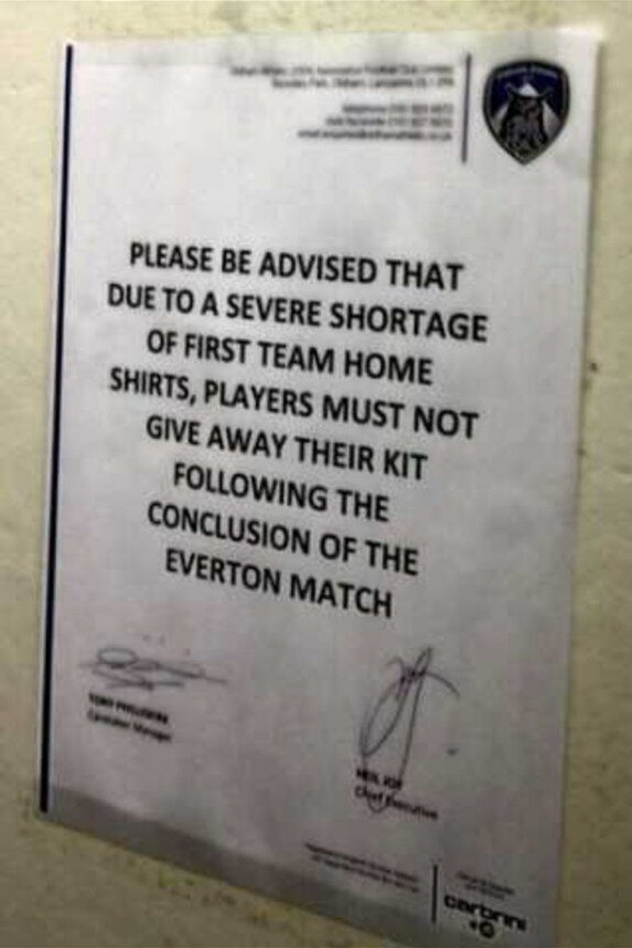A poster in the Oldham tunnel signed by caretaker manager Tony Philliskirk and chief executive Neil Joy