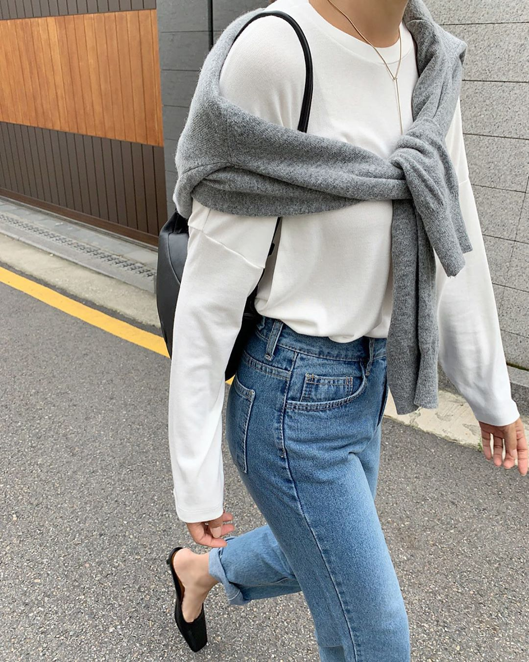 Fall Weekend Outfit Inspiration — Gray Sweater Tied Over The Shoulder, White Tee, Jeans, Black Mules