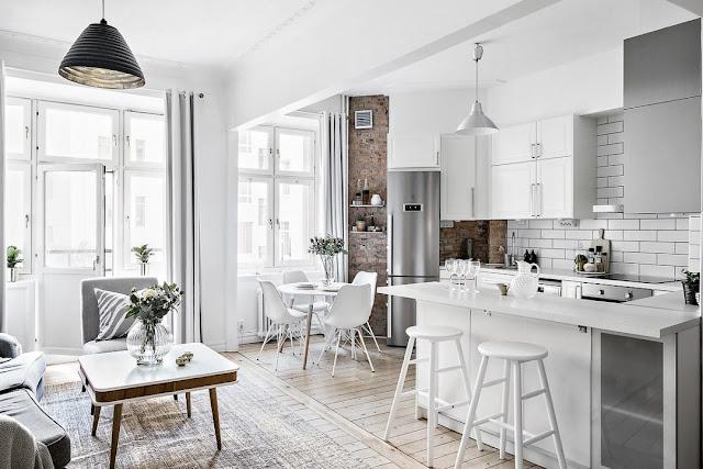 Plan deschis și amenajare în alb și gri pentru un apartament de 50 m²